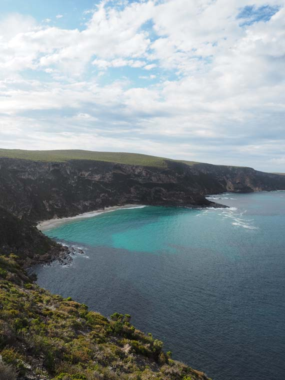 View of the beach and ocean from Weirs Cove